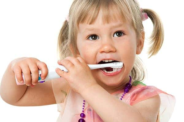Child shows brushing technique