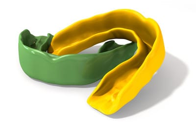 Green and blue mouth guards on display made by dentist in bendigo
