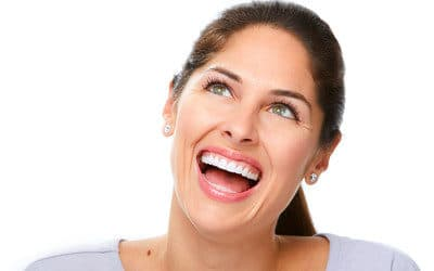 Lady showing her white teeth after teeth whitening