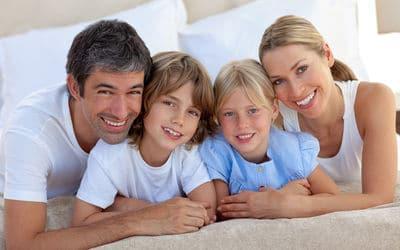 Smiling whole family after teeth check up at Bendigo dental