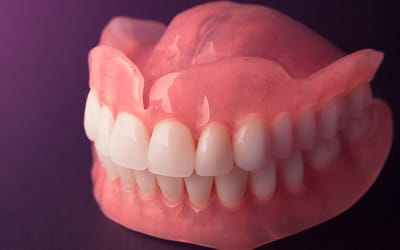 Upper and lower dentures on display made by Bendigo Dental group laboratory